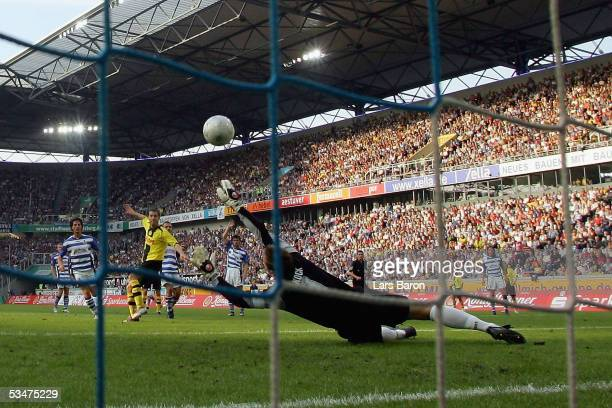 Lars Ricken of Dortmund scores the first goal against Goalkeeper Georg Koch of Duisburg during the Bundesliga match between MSV Duisburg and Borussia...