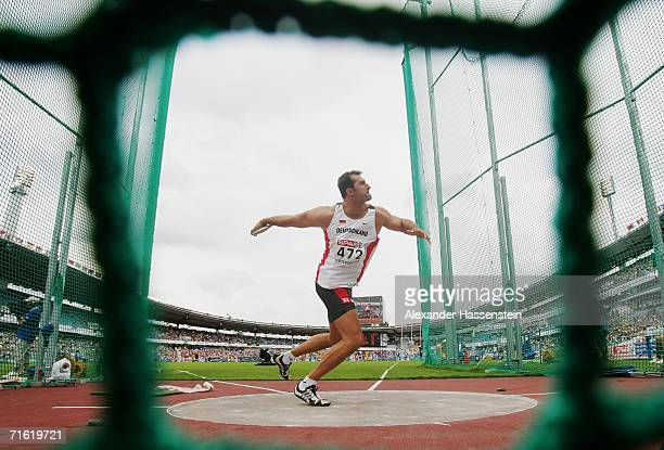 Lars Riedel of Germany competes during the Men's Discus throw Qualifying Round on day four of the 19th European Athletics Championships at the Ullevi...