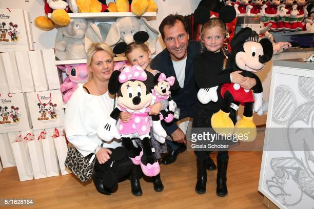 Lars Riedel with his wife Katja Riedel daughter Paula Riedel and Emma Riedel Mickey Mouse and Minnie Mouse during the Disney Store VIP opening on...