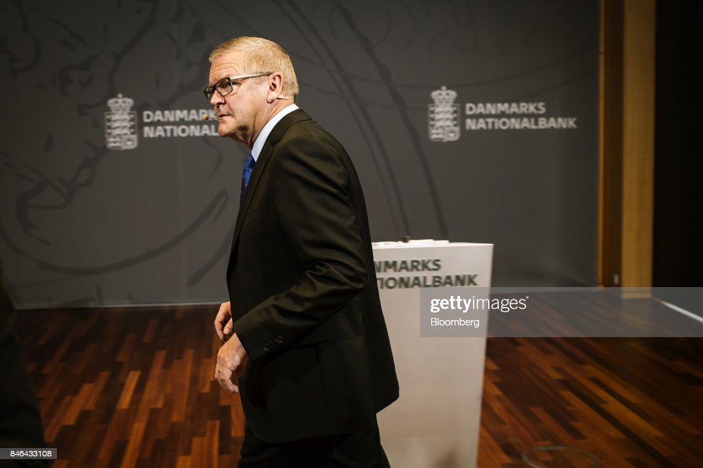Lars Rohde, governor of Denmark's central bank, exits after speaking at a news conference at the bank's headquarters in Copenhagen, Denmark, on Wednesday, Sept. 13, 2017. 'We have previously seen that the economy can overheat vigorously and suddenly when it is booming, Rohdesaid in a statement on Wednesday.Photographer: Carsten Snejbjerg/Bloomberg via Getty Images