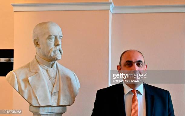 Lars Schaade, vice-president of the Robert Koch Institute for public health , poses next to a bust of German physician, microbiologists and one of...