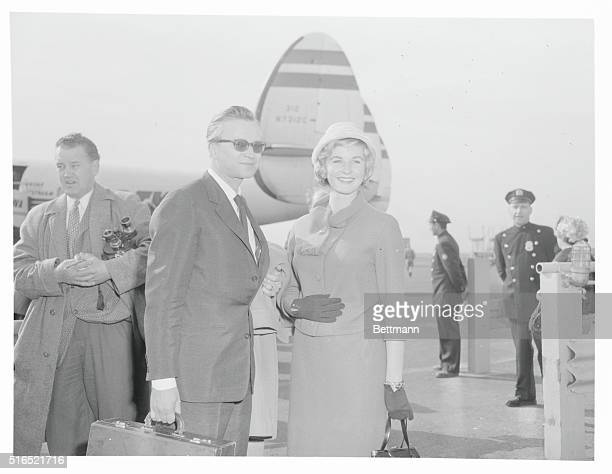 Lars Schmidt with Bergman's daughter, Pia Lindström, at Idlewild Airport on their arrival in New York, 8th April 1959.