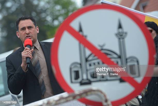 Lars Seidensticker, chairman of the Pro NRW party in Berlin, delivers a speech during the Pro NRW far-right anti-Islam political party protest...