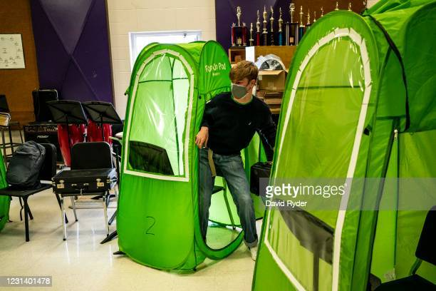 Lars Sorom leaves his pop-up tent during wind ensemble class at Wenatchee High School on February 26, 2021 in Wenatchee, Washington. The school has...