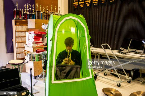 Lars Sorom plays the trumpet in his pop-up tent during wind ensemble class at Wenatchee High School on February 26, 2021 in Wenatchee, Washington....