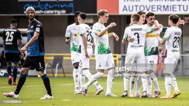 Lars Stidnl of Mönchengladbach celebrates with team mates after scoring his teams second goal during the Bundesliga match between SC Paderborn 07 and...