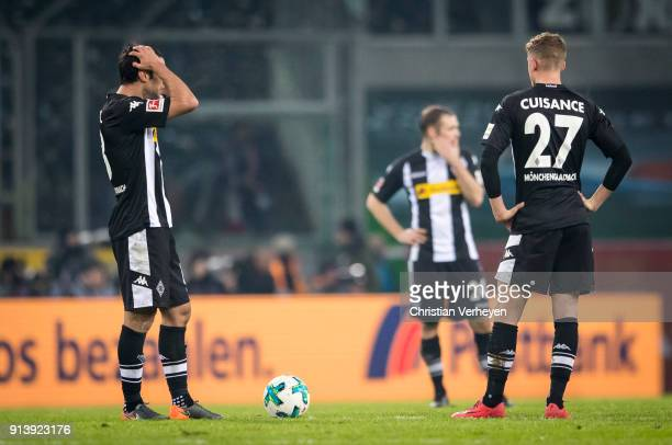 Lars Stindl and Michael Cuisance of Borussia Moenchengladbach react after the 01 during the Bundesliga match between Borussia Moenchengladbach and RB...