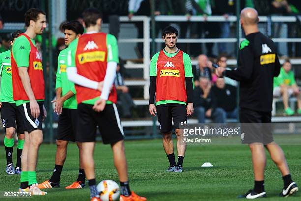 Lars Stindl and team mates listen to head coach Andre Schubert during a Borussia Moenchengladbach training session on day 3 of the Bundesliga Belek...