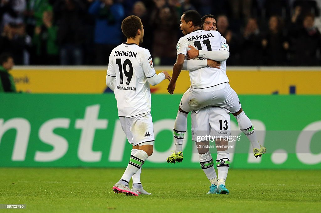 Lars Stindl, Fabian Johnson and Raffael of Borussia Moenchengladbach celebrate after the third goal during the Bundesliga match between Borussia Moenchengladbach and FC Augsburg at Borussia-Park on September 23, 2015 in Moenchengladbach, Germany