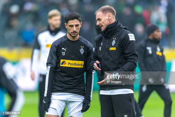 Lars Stindl of Borussia Moenchengladbach and assistant coach Alexander Zickler of Borussia Moenchengladbach looks on prior to the Bundesliga match...