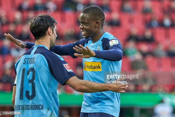 Lars Stindl of Borussia Moenchengladbach and Denis Zakaria of Borussia Moenchengladbach celebrates after scoring his team`s third goal during the...