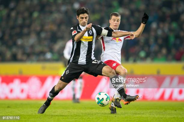 Lars Stindl of Borussia Moenchengladbach and Diego Demme of RB Leipzig battle for the ball during the Bundesliga match between Borussia...