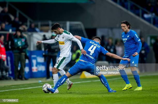 Lars Stindl of Borussia Moenchengladbach and Ermin Bicakcic of 1899 Hoffenheim battle for the ball during the Bundesliga match between TSG 1899...
