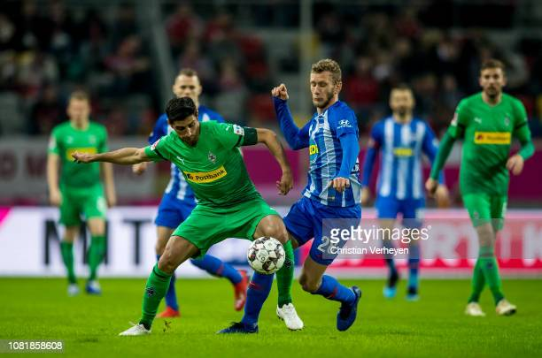 Lars Stindl of Borussia Moenchengladbach and Fabian Lustenberger of Hertha BSC battle for the ball during the Telekom Cup match between Borussia...