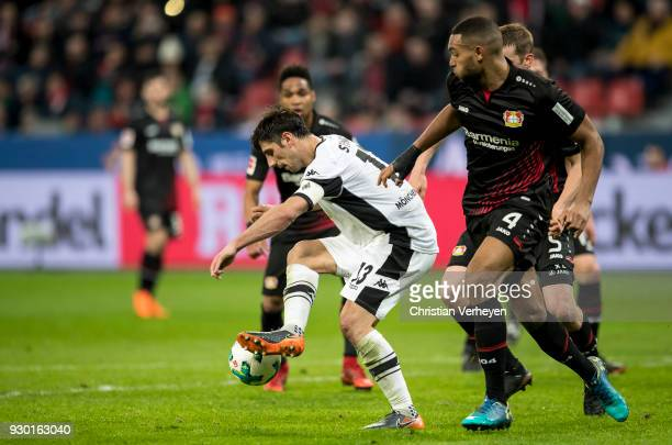 Lars Stindl of Borussia Moenchengladbach and Jonathan Tah of Bayer 04 Leverkusen battle for the ball during the Bundesliga match between Bayer 04...