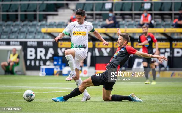 Lars Stindl of Borussia Moenchengladbach and Marko Grujic of Hertha BSC during the Bundesliga match between Borussia Moenchengladbach and Hertha BSC...