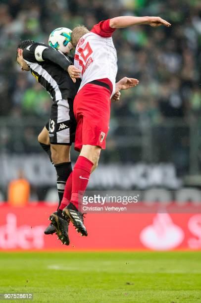 Lars Stindl of Borussia Moenchengladbach and Martin Hinteregger of FC Augsburg battle for the ball during the Bundesliga match between Borussia...