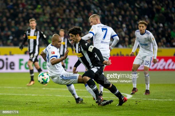Lars Stindl of Borussia Moenchengladbach and Naldo of FC Schalke 04 battle for the ball during the Bundesliga match between Borussia Moenchengladbach...