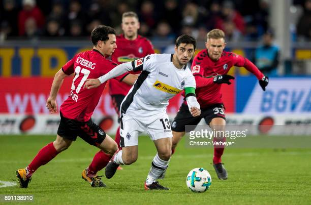Lars Stindl of Borussia Moenchengladbach and Nicolas Hoefler of SC Freiburg battle for the ball during the Bundesliga match between SC Freiburg and...