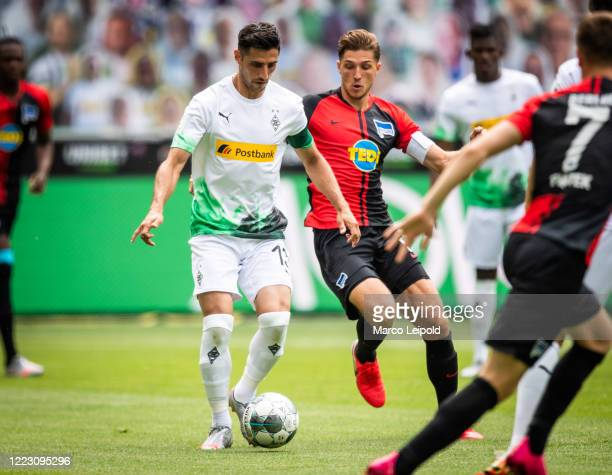 Lars Stindl of Borussia Moenchengladbach and Niklas Stark of Hertha BSC during the Bundesliga match between Borussia Moenchengladbach and Hertha BSC...