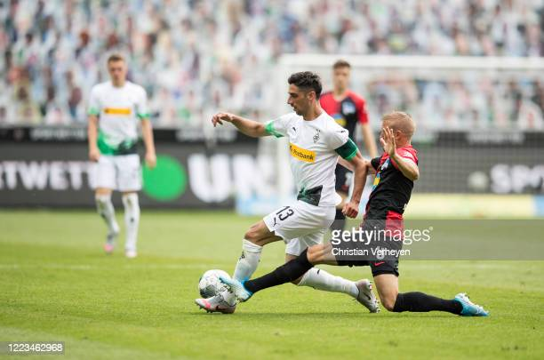Lars Stindl of Borussia Moenchengladbach and Per Ciljan Skjelbred of Hertha BSC in action during the Bundesliga match between Borussia...