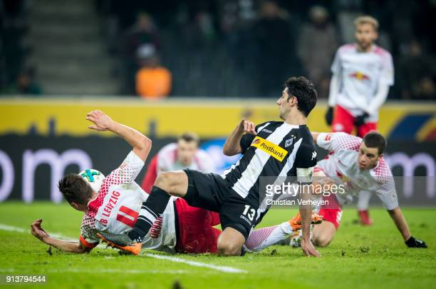 Lars Stindl of Borussia Moenchengladbach and Willi Orban of RB Leipzig battle for the ball during the Bundesliga match between Borussia...