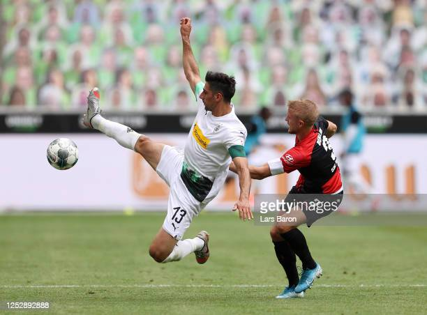Lars Stindl of Borussia Moenchengladbach battles for possession with Per Ciljan Skjelbreid of Hertha BSC during the Bundesliga match between Borussia...