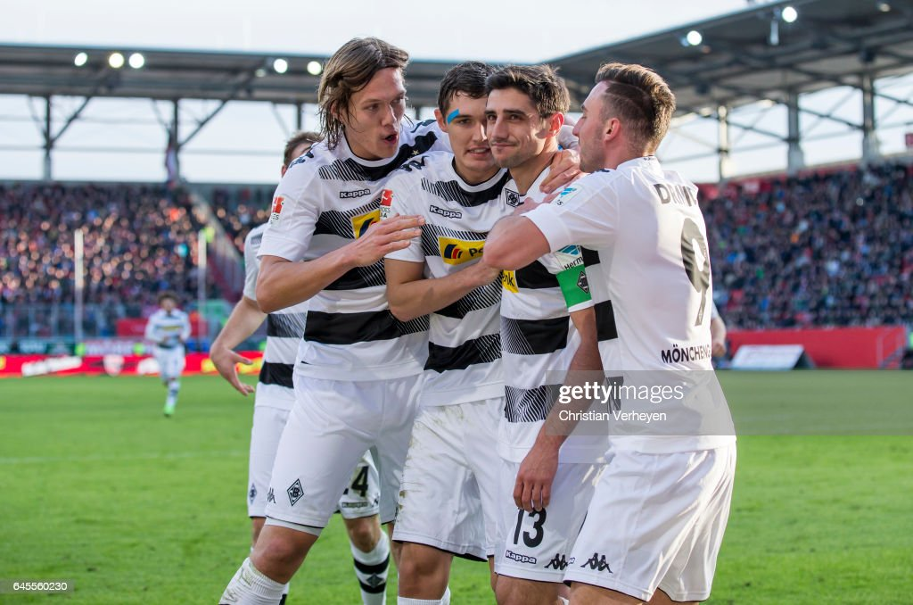 Lars Stindl of Borussia Moenchengladbach celebrate with his team mates after he scores his teams first goal during the Bundesliga match between FC Ingolstadt 04 and Borussia Moenchengladbach at Audi Sportpark on February 26, 2017 in Ingolstadt, Germany.