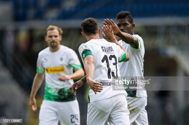 Lars Stindl of Borussia Moenchengladbach celebrate with team mate Breel Embolo after he score his teams second goal during the Bundesliga match...