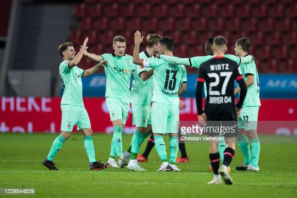 Lars Stindl of Borussia Moenchengladbach celebrate with team mates after he score his teams second goal during the Bundesliga match between Bayer 04...