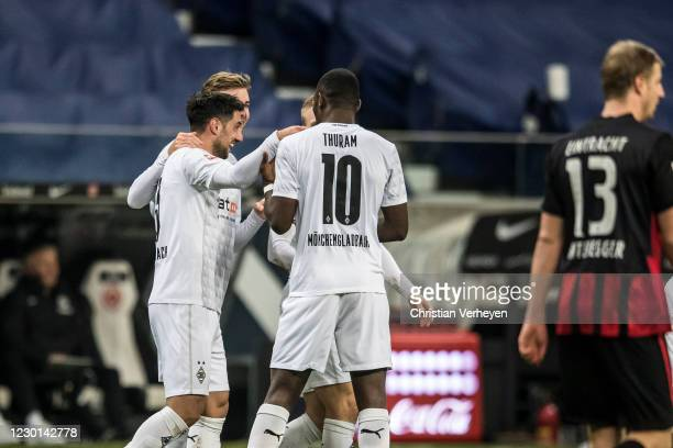 Lars Stindl of Borussia Moenchengladbach celebrate with team mates after he score his teams first goal during the Bundesliga match between Eintracht...