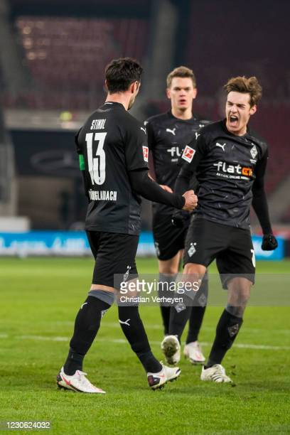Lars Stindl of Borussia Moenchengladbach celebrate with team mates after he score his teams first goal by penalty during the Bundesliga match between...