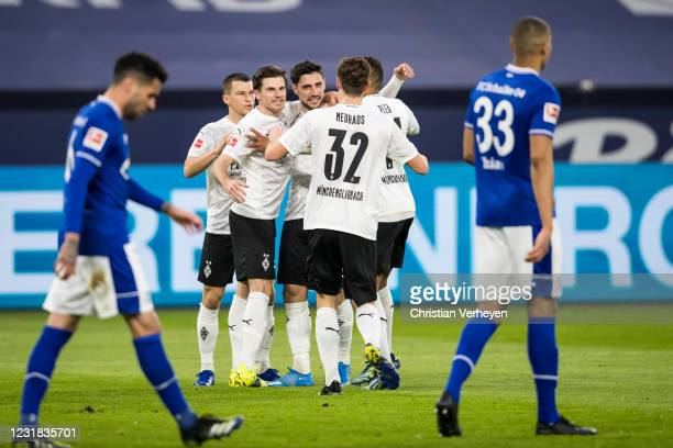 Lars Stindl of Borussia Moenchengladbach celebrate with team mates after he score his teams first goal during the Bundesliga match between FC Schalke...