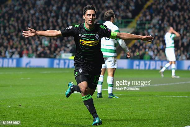 Lars Stindl of Borussia Moenchengladbach celebrates after scoring the opening goal of the game during the UEFA Champions League group C match between...