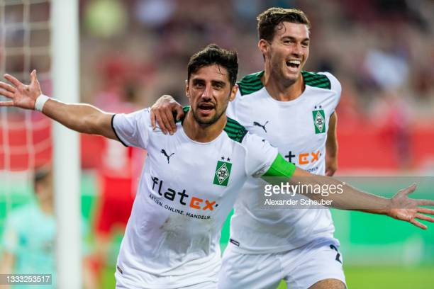 Lars Stindl of Borussia Moenchengladbach celebrates the first goal for his team with Florian Neuhaus of Borussia Moenchengladbach during the DFB Cup...
