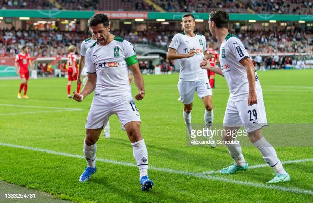 Lars Stindl of Borussia Moenchengladbach celebrates the first goal for his team wit his teammates during the DFB Cup first round match between 1. FC...