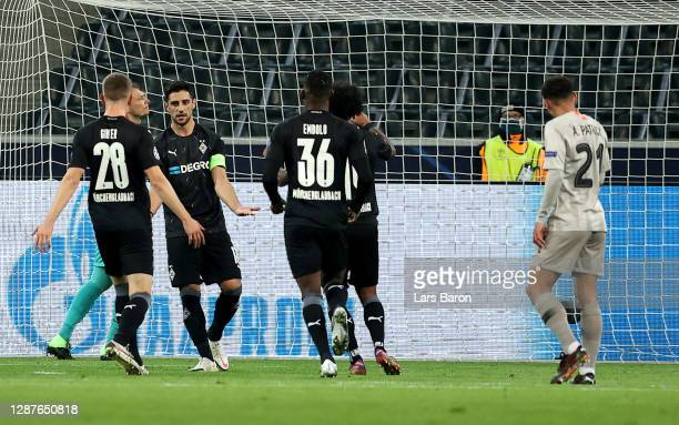 Lars Stindl of Borussia Moenchengladbach celebrates with Breel Embolo Valentino Lazaro and Matthias Ginter of Borussia Moenchengladbach after scoring...