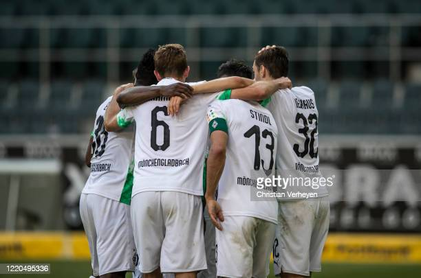 Lars Stindl of Borussia Moenchengladbach celebrates with his teammates after he scores his team's third goal during the Bundesliga match between...