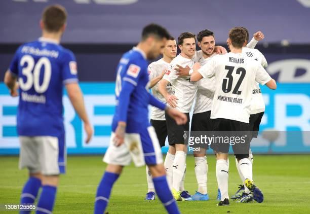 Lars Stindl of Borussia Moenchengladbach celebrates with team mates Florian Neuhaus and Jonas Hofmann after scoring their side's first goal during...