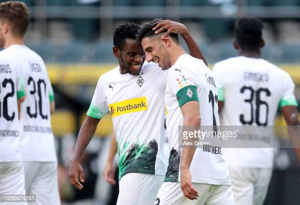 Lars Stindl of Borussia Moenchengladbach celebrates with teammate Ibrahima Traore after scoring his team's third goal during the Bundesliga match...