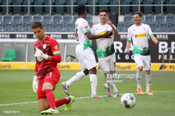 Lars Stindl of Borussia Moenchengladbach celebrates with teammates Breel Embolo and Jonas Hofmann after scoring his team's third goal during the...