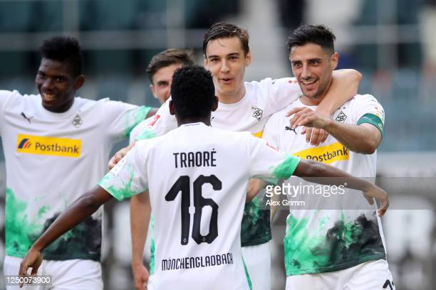 Lars Stindl of Borussia Moenchengladbach celebrates with teammates Florian Neuhaus Breel Embolo and Ibrahima Traore after scoring his team's third...