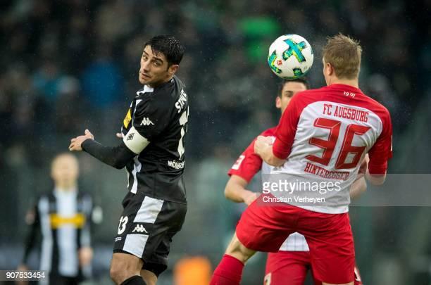 Lars Stindl of Borussia Moenchengladbach controls the ball against Martin Hinteregger of FC Augsburg during the Bundesliga match between Borussia...