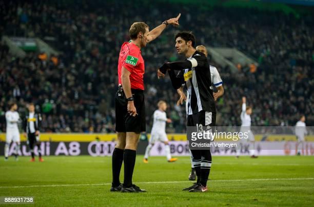 Lars Stindl of Borussia Moenchengladbach discussed with referee Sascha Stegemann during the Bundesliga match between Borussia Moenchengladbach and FC...