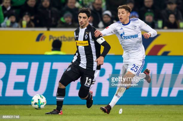 Lars Stindl of Borussia Moenchengladbach is chased by Amine Harit of FC Schalke 04 during the Bundesliga match between Borussia Moenchengladbach and...