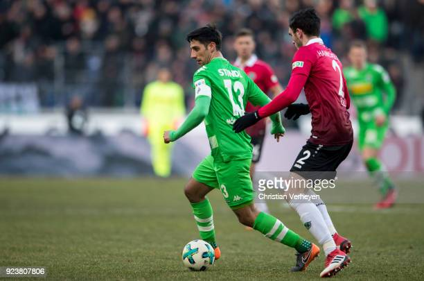 Lars Stindl of Borussia Moenchengladbach is chased by Josip Elen of Hannover 96 during the Bundesliga match between Hannover 96 and Borussia...