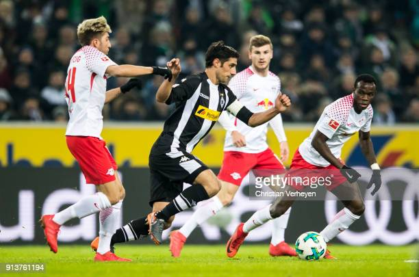 Lars Stindl of Borussia Moenchengladbach is chased by Kevin Kampl of RB Leipzig during the Bundesliga match between Borussia Moenchengladbach and RB...