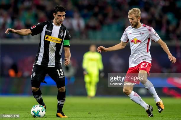 Lars Stindl of Borussia Moenchengladbach is chased by Konrad Laimer of RB Leipzigduring the Bundesliga match between RB Leipzig and Borussia...