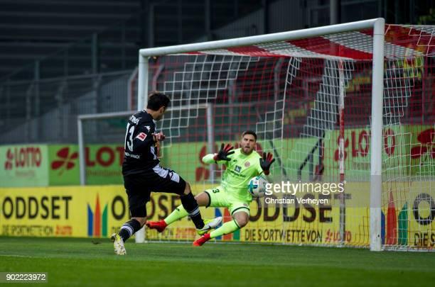 Lars Stindl of Borussia Moenchengladbach scores his teams first goal during the preseason friendly match between 1 FSV Mainz 05 and Borussia...