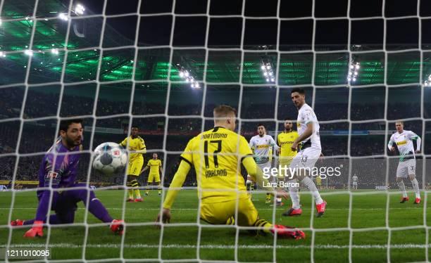 Lars Stindl of Borussia Moenchengladbach scores his team's second goal during the Bundesliga match between Borussia Moenchengladbach and Borussia...